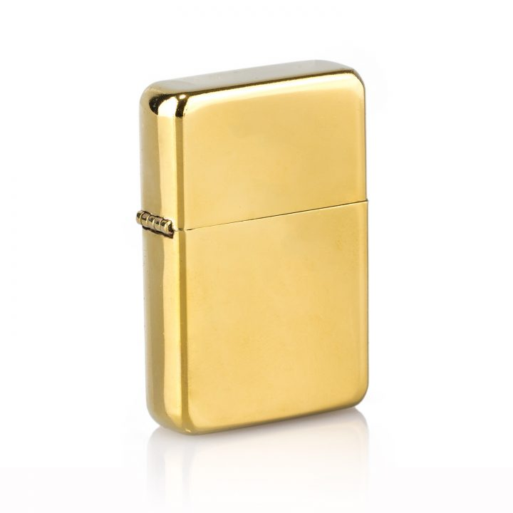 Personalised gold lighter on white background