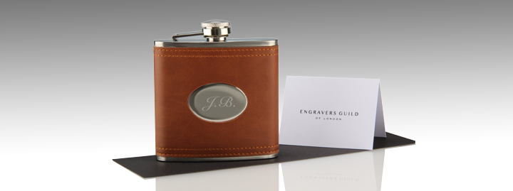 hip flask with brown leather wrap and personalised engraving